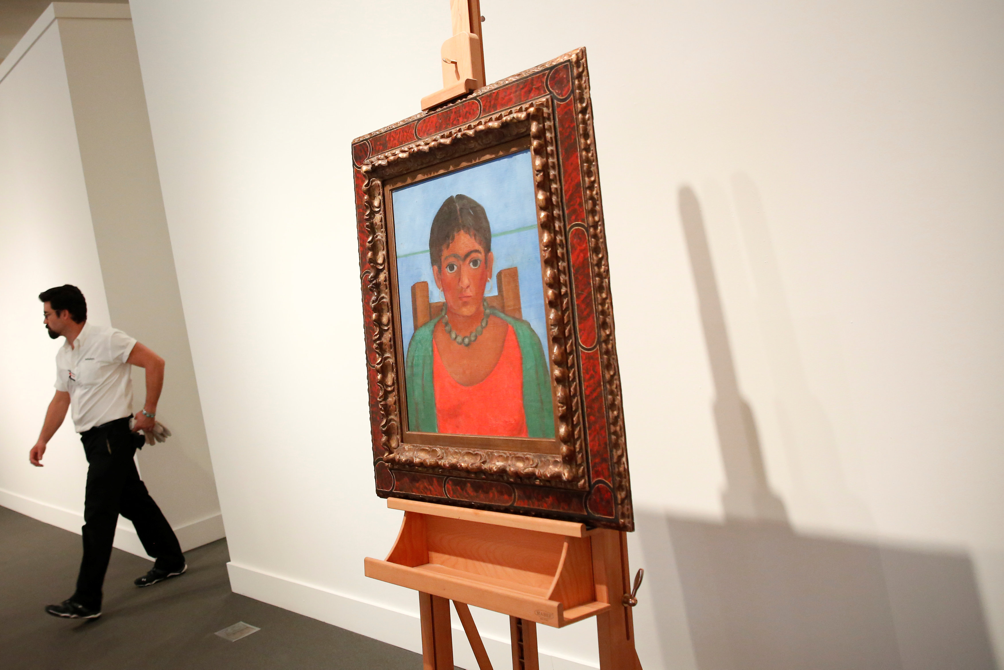 Artis Frida Kahlo's painting 'Nina Con Collar' sits on an easel at Sotheby's auction house in New York