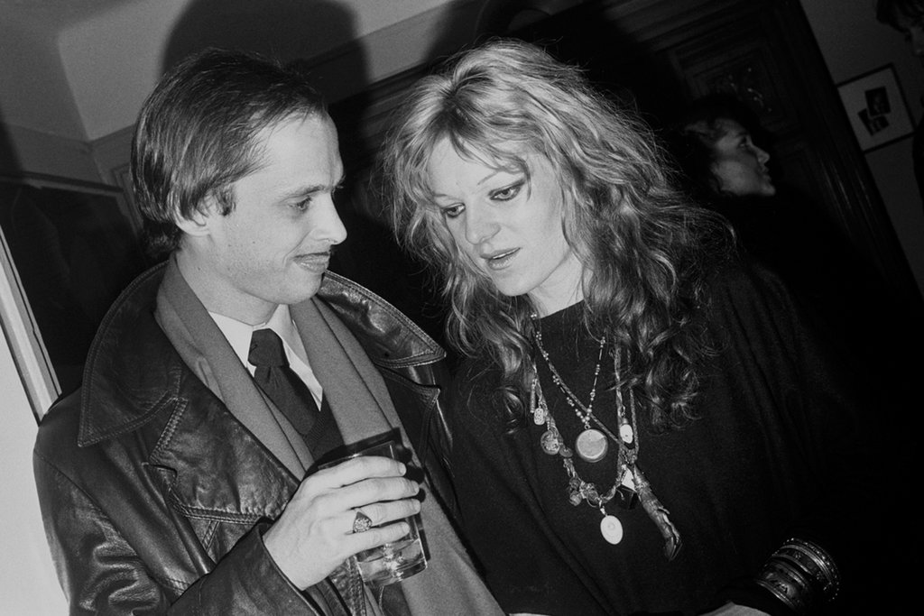 Cookie Mueller with John Waters at a New York party, 1977. Photo by Bobby Grossman, courtesy of Max Mueller.