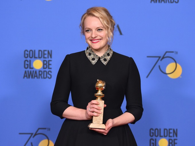 Elisabeth Moss won the award for best actress in a TV series for her role in The Handmaid's Tale Credit: AP
