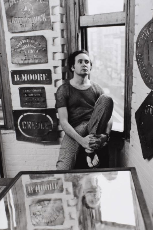 Robert Indiana with stencils in his Coenties Slip studio, 1963. Photo by William John Kennedy. Collection of the Indianapolis Museum of Art.